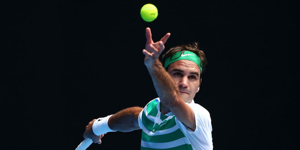 Roger Federer eased into the third round. Photo / Getty