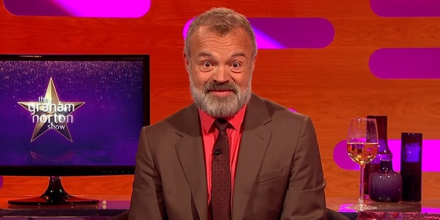 Loading Graham Norton was impressed with Brad Baxter's story about tipping an urn of ashes. Photo / YouTube.