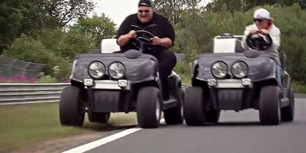 Dotcom looks delighted as he races an open-top buggy around the track.