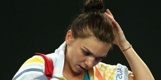 Simona Halep reacts after losing her first round clash at the Australian Open. Photo / Getty images