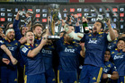 Highlanders co-captains Ben Smith and Nasi Manu hoist the Super Rugby trophy.