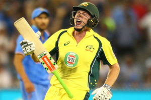 James Faulkner of Australia celebrates hitting the winning runs against India. Photo / Getty