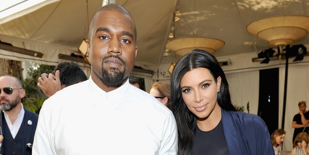 Kanye West and wife Kim Kardashian are at odds as to whether they want to have more children. Photo / Getty