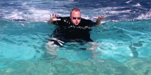 Kim Dotcom is pictured living it up in the pool in his new video for Good Life.