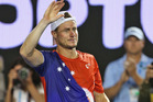 Lleyton Hewitt waves to fans after his final match at the Australian Open. Photo / Getty