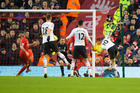 Manchester United's Wayne Rooney, right, scores against Liverpool - just his second career goal at Anfield. Photo / AP