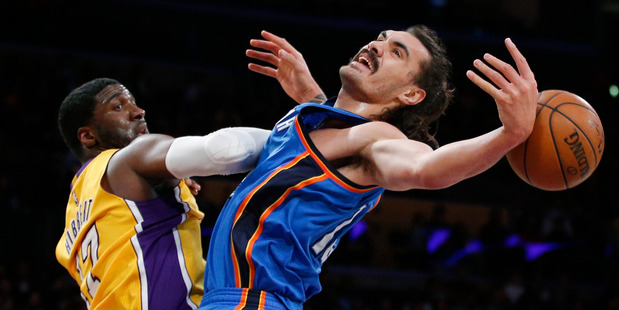 Oklahoma City Thunder's Steven Adams, right, is fouled by Los Angeles Lakers' Roy Hibbert. photo / AP