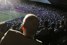 Fans watch a tennis match at Wimbledon. Photo / AP