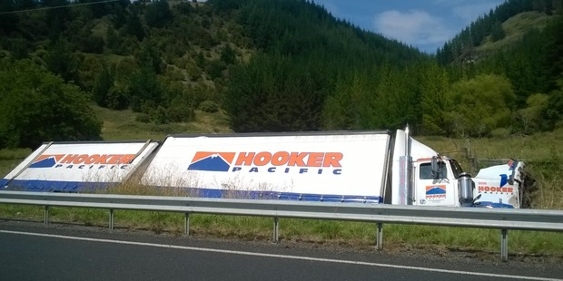 A truck rolled on State Highway 2 near Waipatiki this morning after a truck rolled. PHOTO/WARREN BUCKLAND.
