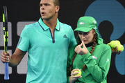France's Jo-Wilfried Tsonga escorts an ill ballgirl off the court. Photo / Getty