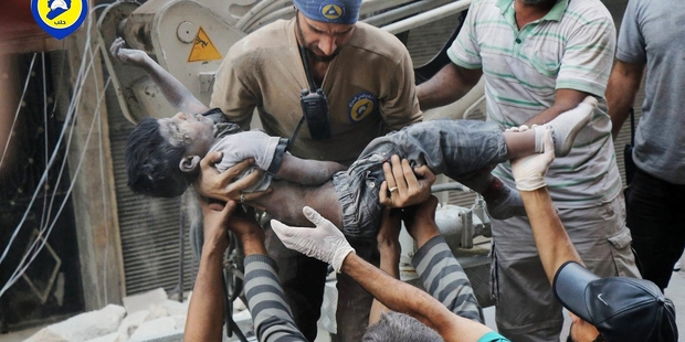 Workers from the Syrian Civil Defence group known as the White Helmets were busy this week as airstrikes in Aleppo killed about 100 children and injured many more. Picture / AP