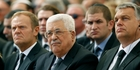Mahmoud Abbas (centre) sits with European Council President Donald Tusk (left) at yesterday's funeral. Photo / AP