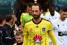 Wellington Phoenix captain Andrew Durante leads his team out prior to a pre-season match against A-League rivals Central Coast Mariners last week. Photo / Photosport
