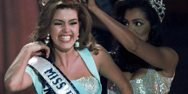 In this May 17, 1996, file photo, the new Miss Universe Alicia Machado of Venezuela reacts as she is crowned by the 1995 winner Chelsi Smith at the Miss Universe competition in Las Vegas. Photo / AP