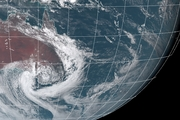 A satellite shows the storm cell and uprooted trees are seen in Blyth, South Australia. Pictures / JMA, AAP