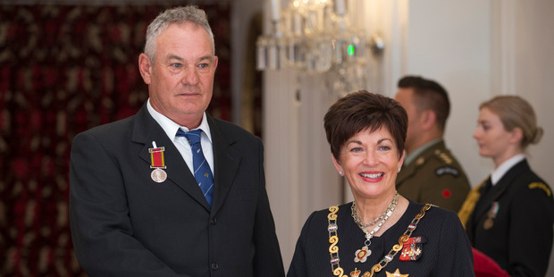 Loading Murray Michie with the Governor-General, Dame Patsy Reddy, after receiving the Royal Humane Society of NZ Silver Medal for bravery. Photo / Mark Mitchell