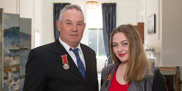 Murray Michie and Payge Olds after receiving the Royal Humane Society of NZ Silver Medal for bravery, at Government House in Wellington. Photo / Mark Mitchell