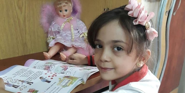 Bana al-Abed tweeted a photo of herself with the comment, 'I am reading to forget the war.'