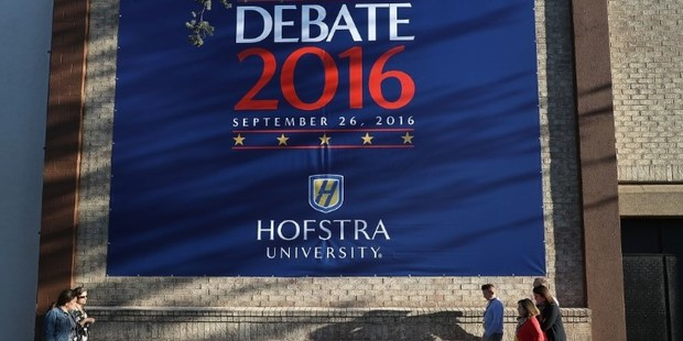 A debate sign hangs on a wall outside the media center setup for the first U.S. presidential debate at Hofstra University. Photo / AFP