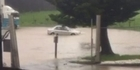 Watch: Car tries to drive through Auckland flooding
