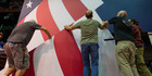 Construction crews hang part of the set as preparations continue for the presidential debate between Democratic Hillary Clinton and Republican candidate Donald Trump in New York. Photo / AP