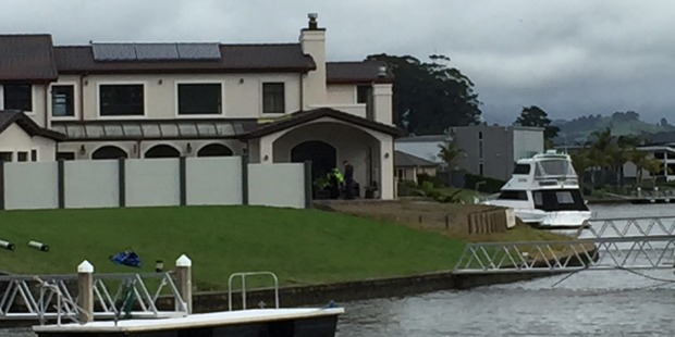 Police search an Aquila Drive property in Whitianga where it's believed a cap belonging to missing man Luke Cochrane was found today. Photo / Belinda Feek
