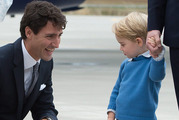 Canadian Prime Minister Justin Trudeau kneels to talk to Prince George. Photo / AP
