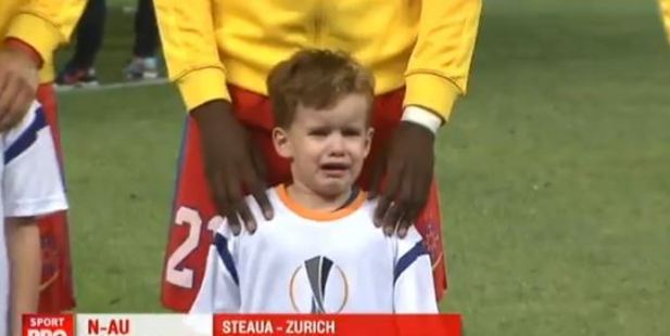 A young fan at a Europa League football match was less than excited about his appearance in front of 50,000 people. Photo / Sport Pro TV