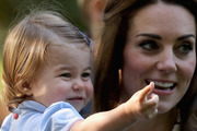 """Princess Charlotte uttered the word """"pop"""" as she hugged a stand of balloons. Photo / Getty"""