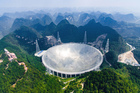An aerial view shows the Five-hundred-meter Aperture Spherical Telescope (FAST) in the remote Pingtang county in southwest China. Photo / AP