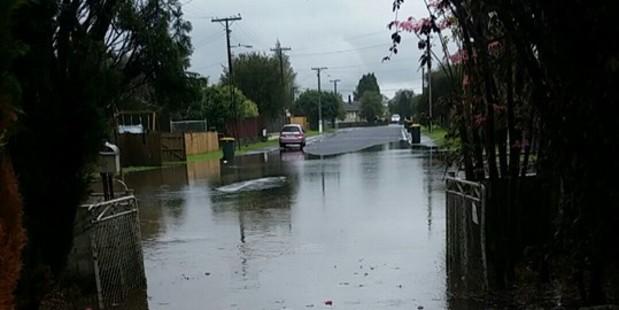Flooding on Salas Place in Papakura. Photo / Ian Patuwai