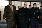 Boy George being escorted into New York Criminal Court in 2006, charged with fourth-degree criminal possession of a controlled substance. Photo / Getty Images