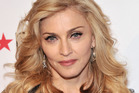 Singer Madonna is stripping off to promote people heading to the polls for 2016 US Election. Photo / Getty