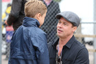 Brad Pitt and his son Knox Jolie-Pitt attend the MotoGP British Grand Prix race at Silverstone ahead of the release of documentary Hitting The Apex. Photo / Getty