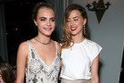 Cara Delevingne and Amber Heard have been hanging out a lot more since Heard's split with Johnny Depp. Photo / Getty