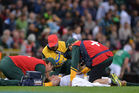 Patrick Lambie of South Africa is attended to by medical personnel before being stretchered from the pitch. Photo / Getty Images