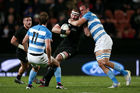 Kieran Read is tackled by Leonardo Senatore during the Rugby Championship. Photo / Getty Images