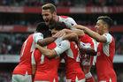 Alexis Sanchez celebrates scoring Arsenal's 1st goal with his teammates. Photo / Getty