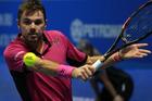 Stan Wawrinka of Switzerland returns the ball to Alexander Zverev. Photo / Getty Images