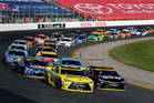 Matt Kenseth and Martin Truex Jr lead the field to the line for a restart. Photo / Getty Images