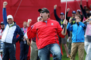 Fan David Johnson of North Dakota reacts after being pulled from the crowd and making a putt on the eighth green during practice. Photo / Getty Images