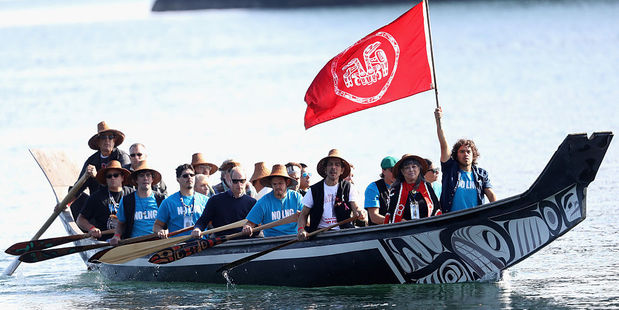 Kate and William arrive in a traditional canoe at Haida Heritage Centre Haida Gwaii, Canada. Photo / Getty Images