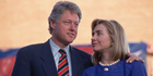 Presidential candidate Bill Clinton and his wife Hillary embrace at a 1992 rally in North Carolina. Photo / Getty Images