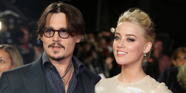 Johnny Depp and Amber Heard only recently divorced, Heard claiming she was abused by him. Photo / AP