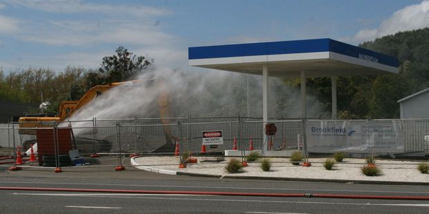 Fire officers sprayed the gas leak area with a massive jet of water to prevent the risk of fire. PHOTO/ASHLEIGH COLLIS