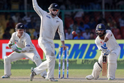 India's Murali Vijay, right, plays a shot while Tom Latham does an interpretive dance. Photo / AP