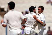 New Zealand's Trent Boult, right, celebrates with teammates after claiming the wicket of Indian captain Virat Kohli. Photo / AP