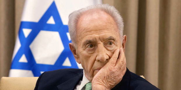Former Israeli President Shimon Peres, listens during a meeting at the president's residence in Jerusalem. Photo / AP