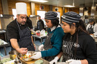 Hospitality tutor Karl Brown gives a lesson on fruit salad, with Southern Cross students Luisa Pulu, 16, left, and Bettina Adriano, 17. Photo/Jason Oxenham