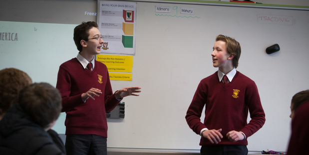 """Michael Newell (left) and Logan Holcroft during a debate in a """"Dystopian Fiction"""" class at Heretaunga College, Upper Hutt. Photo/Natalie Slade"""